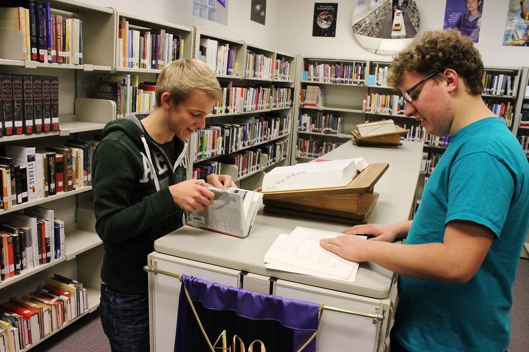 Dallas Larsen, left, and Luke Nelson study in the Foothill High School library in Henderson on Dec. 18, 2013. (Las Vegas Review-Journal, file)