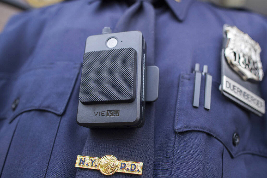 In this April 27, 2017 file photo, a police officer wears a newly-issued body camera outside in New York. In 2018, the New York City Police Department, the nation's largest, stopped releasing bo ...
