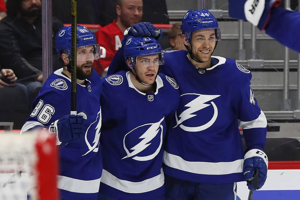 Tampa Bay Lightning center Brayden Point, center, celebrates his goal with Nikita Kucherov (86) and Tampa Bay Lightning defenseman Jan Rutta, right, in the third period of an NHL hockey game again ...
