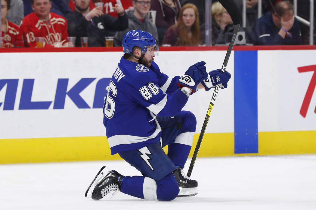 Tampa Bay Lightning right wing Nikita Kucherov (86) celebrates his goal against the Detroit Red Wings in the third period of an NHL hockey game, Thursday, March 14, 2019, in Detroit. (AP Photo/Pau ...
