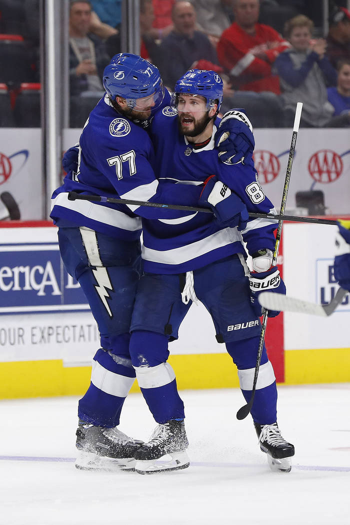 Tampa Bay Lightning right wing Nikita Kucherov (86) celebrates his goal with Victor Hedman (77) in the third period of an NHL hockey game against the Detroit Red Wings, Thursday, March 14, 2019, i ...