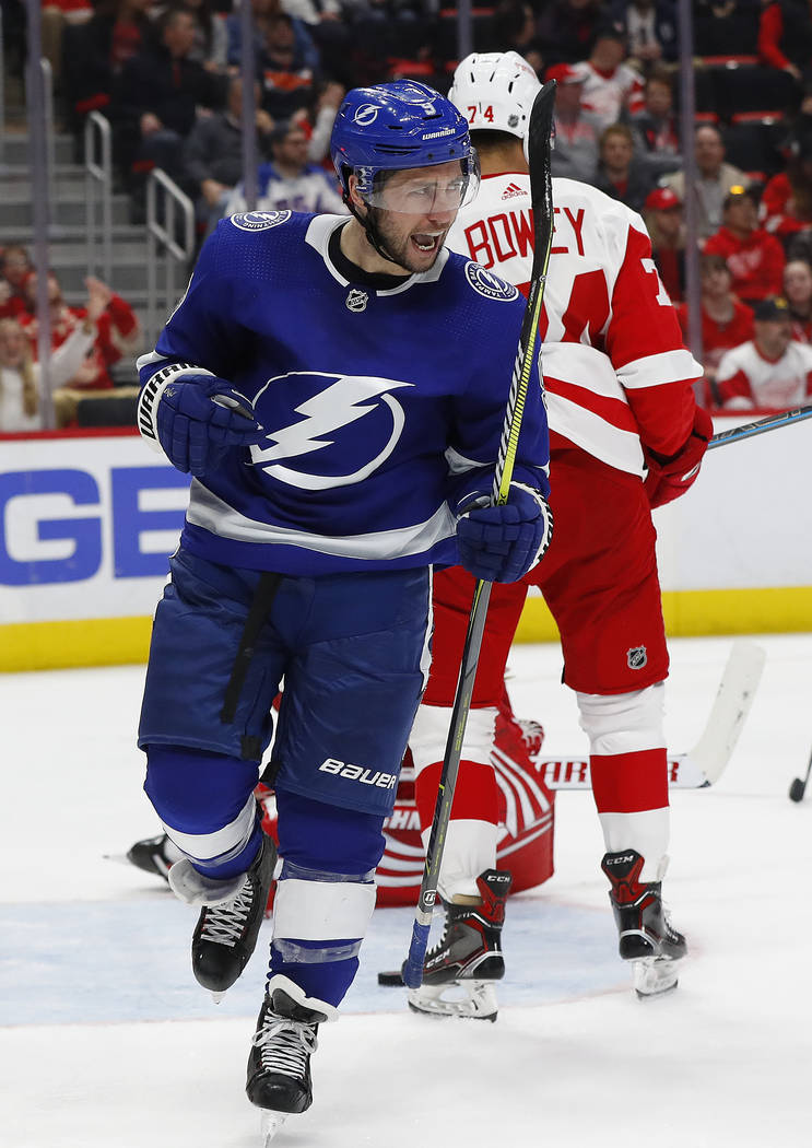 Tampa Bay Lightning center Tyler Johnson (9) celebrates his goal against the Detroit Red Wings in the third period of an NHL hockey game, Thursday, March 14, 2019, in Detroit. (AP Photo/Paul Sancya)