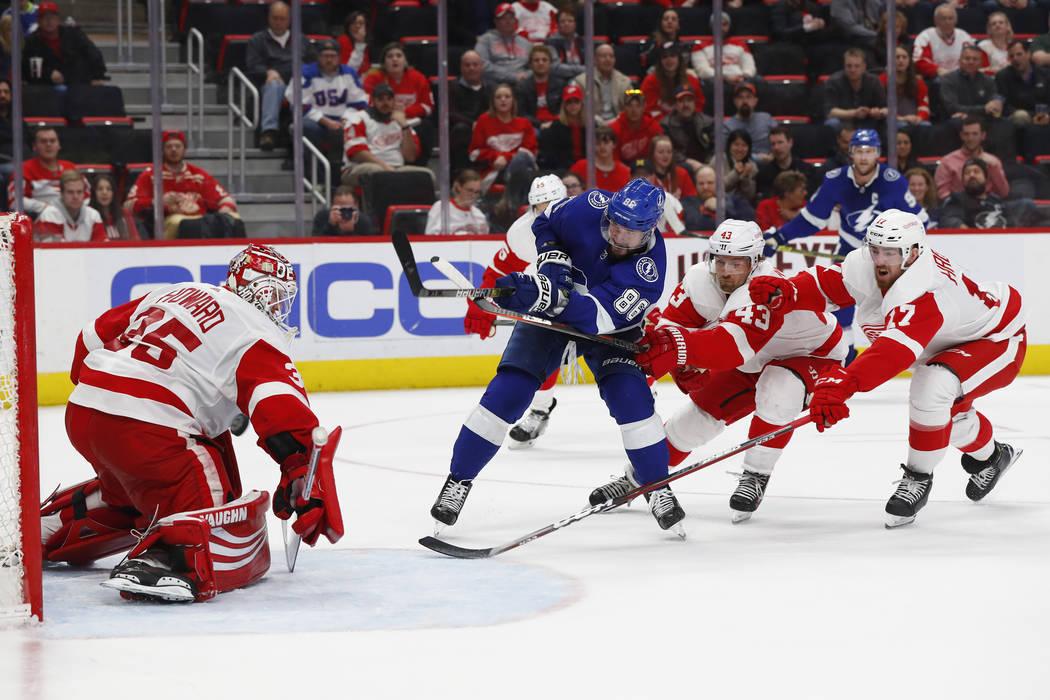 Tampa Bay Lightning's Nikita Kucherov (86) scores a goal on Detroit Red Wings goaltender Jimmy Howard (35) as Darren Helm (43) and Filip Hronek (17) defend in the third period of an NHL hockey gam ...