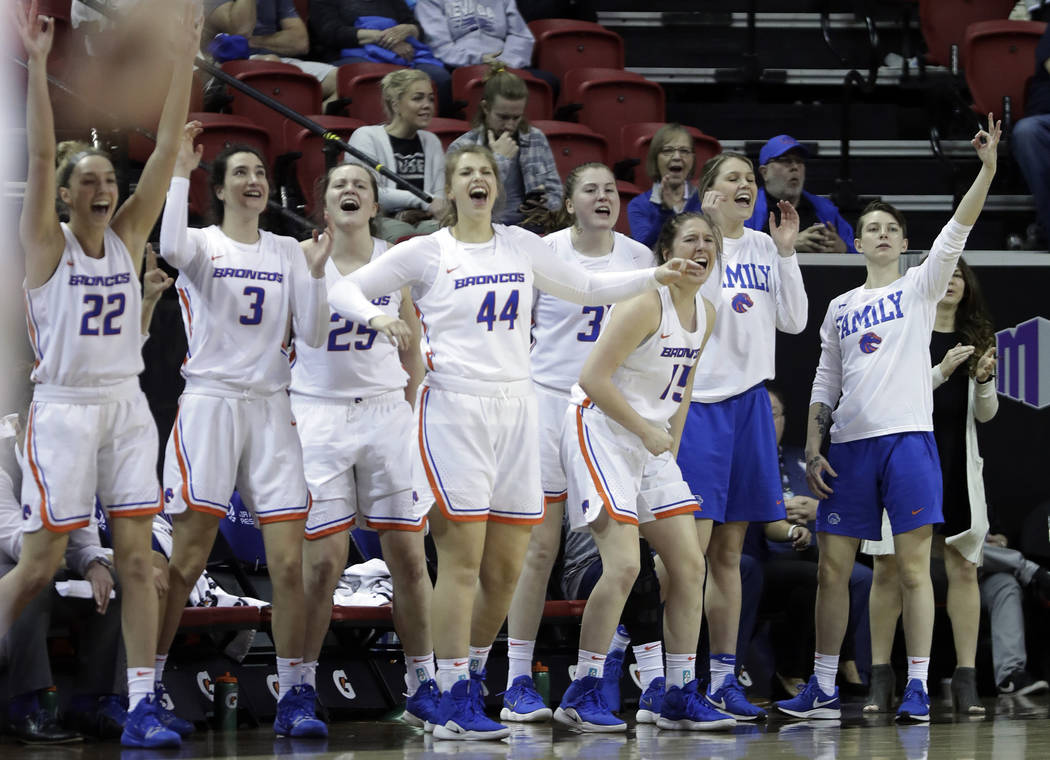 Boise State's bench reacts after a teammate's 3-pointer during the first half of an NCAA college basketball game against Wyoming for the Mountain West Conference women's tournament championship We ...