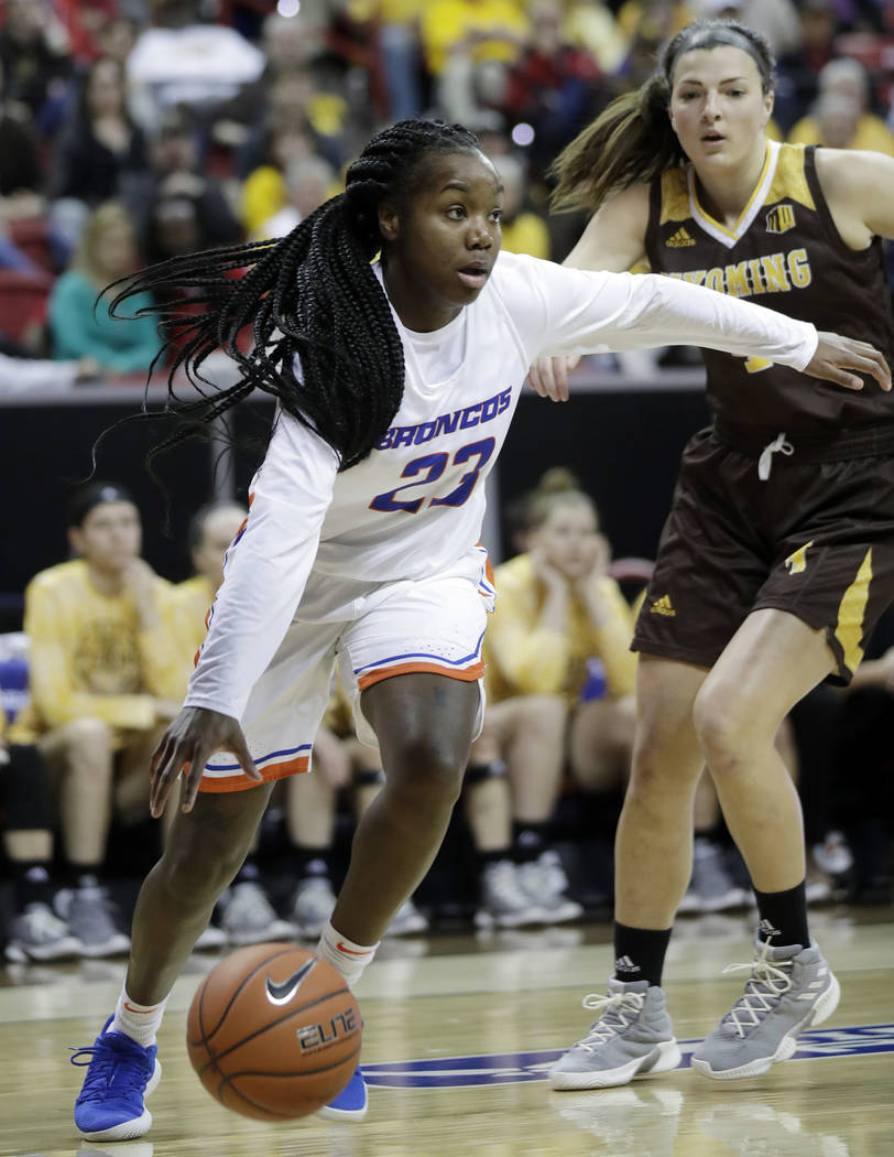 Boise State's Jayde Christopher (23) drives as Wyoming's Taylor Rusk defends during the first half of an NCAA college basketball game for the Mountain West Conference women's tournament championsh ...