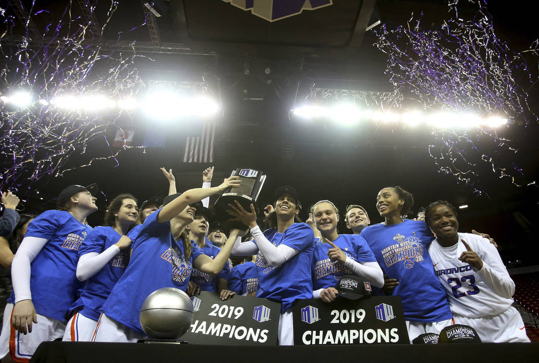 Boise State celebrates defeating Wyoming 68-51 in an NCAA college basketball game for the Mountain West Conference women's tournament championship Wednesday, March 13, 2019, in Las Vegas. (AP Phot ...
