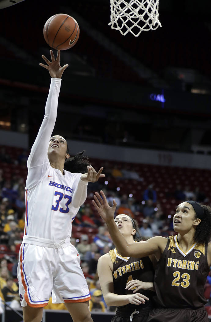 Boise State's Joyce Harrell (33) shoots as Wyoming's Bailee Cotton defends (23) during the first half of an NCAA college basketball game in the Mountain West Conference women's tournament champion ...