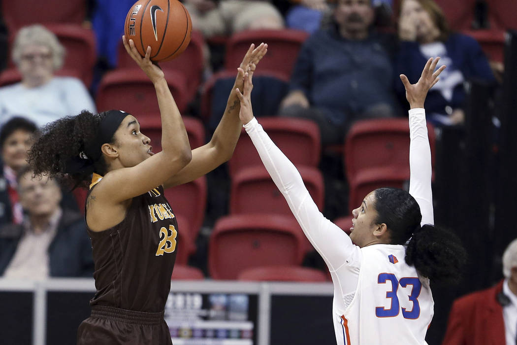 Wyoming's Bailee Cotton (23) shoots as Boise State's Joyce Harrell (33) defends during the first half of an NCAA college basketball game in the Mountain West Conference women's tournament champion ...