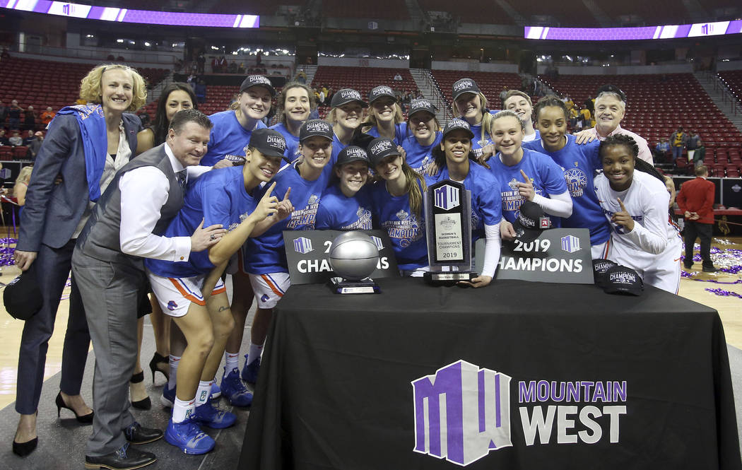 Boise State players pose for photos after defeating Wyoming 68-51 in an NCAA college basketball game for the Mountain West Conference women's tournament championship Wednesday, March 13, 2019, in ...