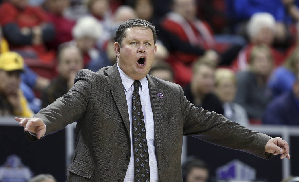 Wyoming coach Joe Legerski shouts to the team during the first half of an NCAA college basketball game against Boise State for the Mountain West Conference women's tournament championship Wednesda ...