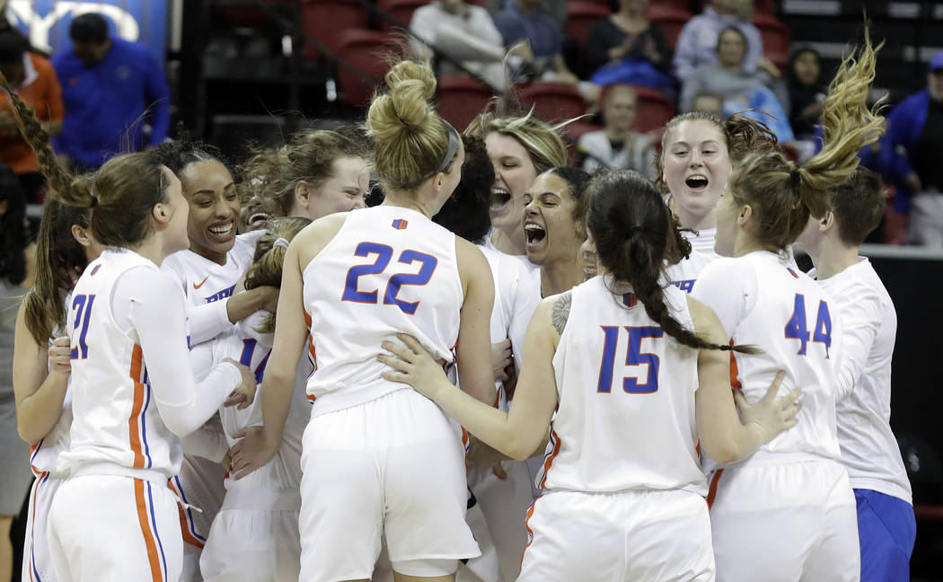 Boise State players celebrate after defeating Wyoming68-51 in an NCAA college basketball game for the Mountain West Conference women's tournament championship Wednesday, March 13, 2019, in Las Veg ...