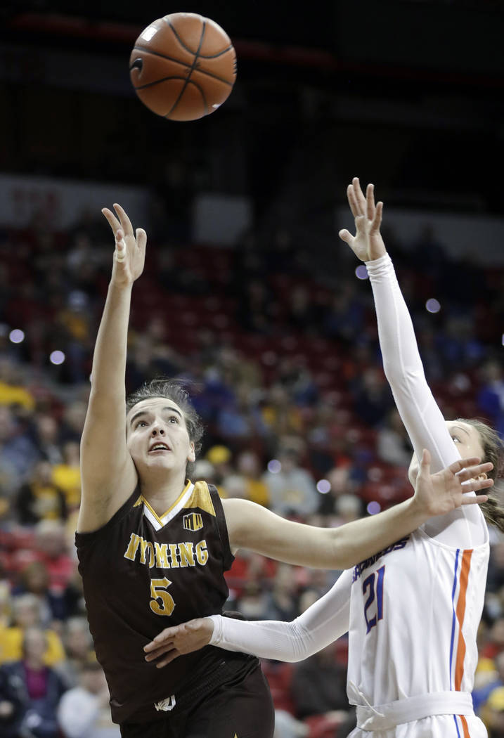 Boise State's Riley Lupfer defends as Wyoming's Sladjana Rakovic (5) shoots during the second half of an NCAA college basketball game for the Mountain West Conference women's tournament championsh ...