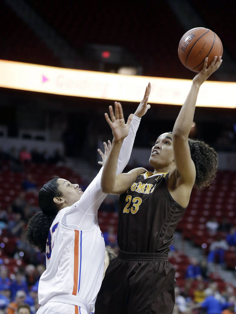 Boise State's Joyce Harrell defends as Wyoming's Bailee Cotton (23) shoots during the second half of an NCAA college basketball game for the Mountain West Conference women's tournament championshi ...