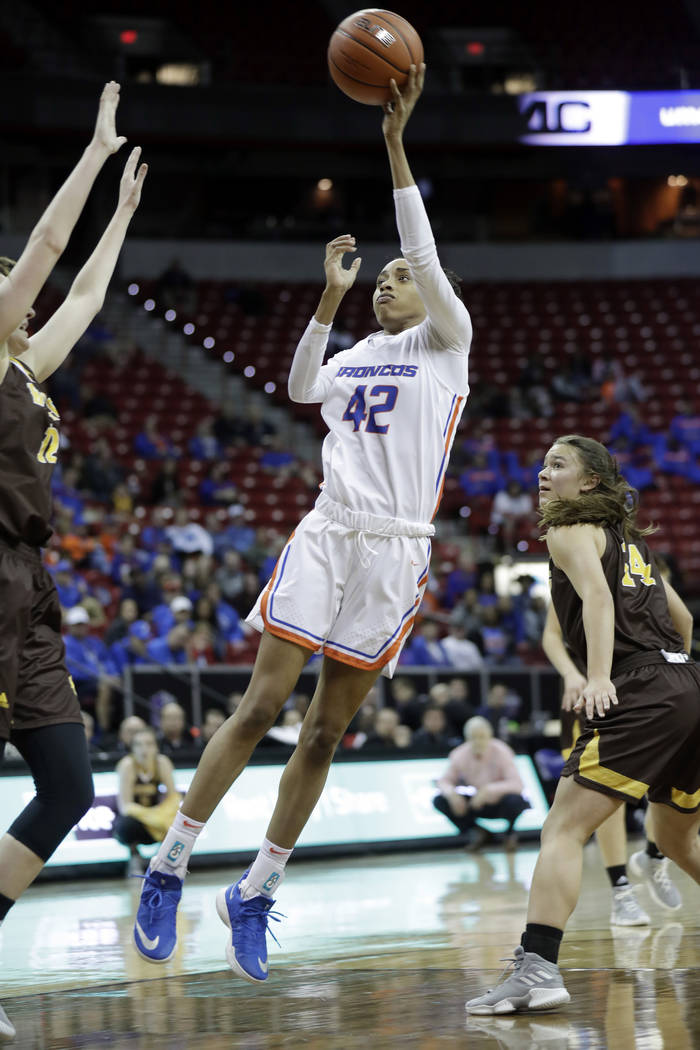 Boise State's A'Shanti Coleman (42) shoots against Wyoming during the first half of an NCAA college basketball game for the Mountain West Conference women's tournament championship Wednesday, Marc ...