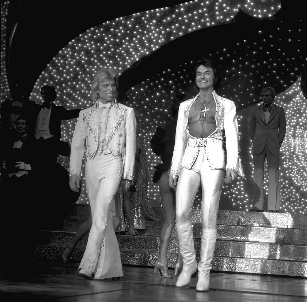 Siegfried Fischbacher, left, and Roy Horn take the stage during their magic show Siegfried & Roy at the Stardust Hotel on Oct. 3, 1980. (Boyd Gaming)