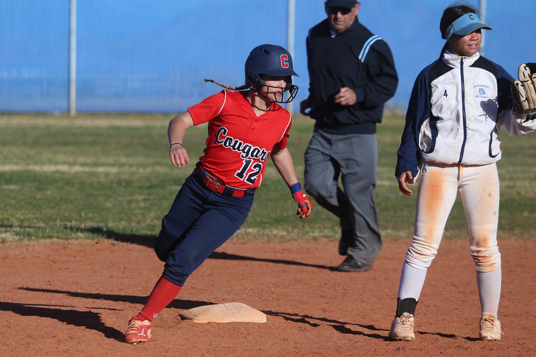Coronado's Paige Sinicki (12) runs safe to second base against Centennial's Samantha Lawrence (4) in the softball game at Centennial High School in Las Vegas, Wednesday, March 13, 2019. Erik Verdu ...