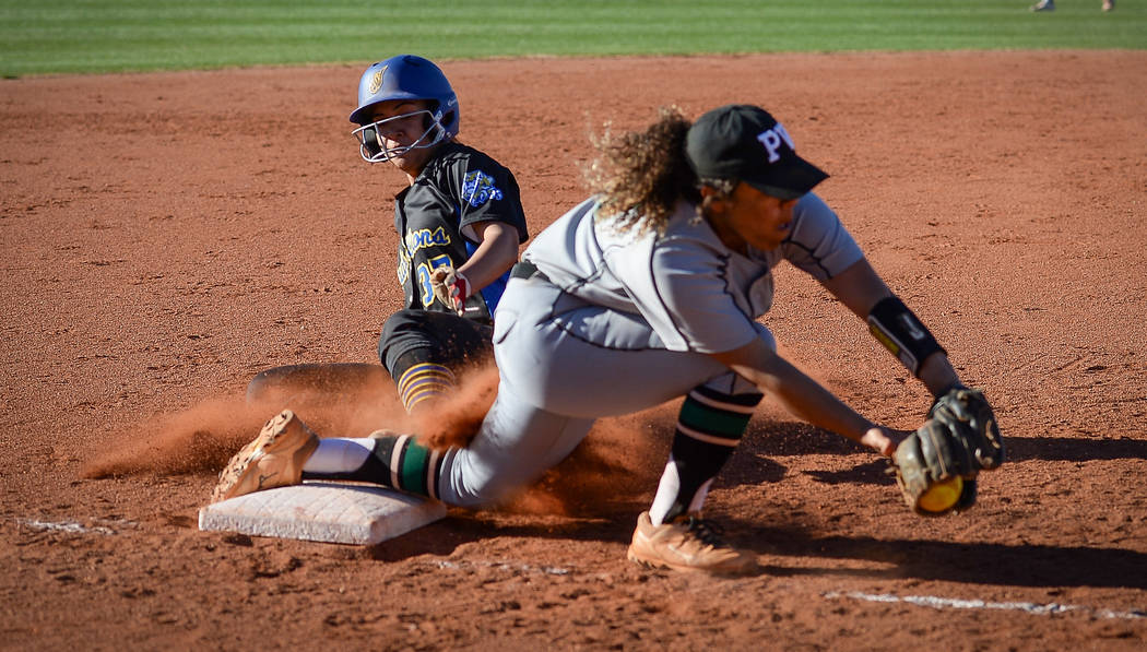 Hola Rosalia Nakayama (37) slides safely into third base as Palo Verde's Maddison Hearn (10) catches the ball in the fourth inning of a softball game against at Palo Verde High School in Las Vegas ...