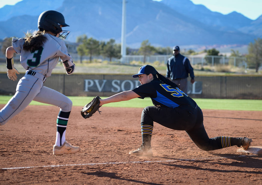 Sierra Vista's Mia Buranamontri (54) catches the ball to get out Palo Verde's Olivia Millsop (3) in the sixth inning of a softball game against at Palo Verde High School in Las Vegas, Thursday, Ma ...