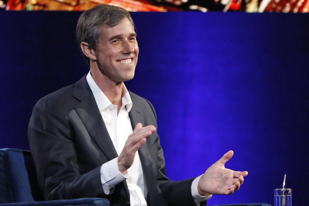 In this Feb. 5, 2019, photo, former Democratic Texas congressman Beto O'Rourke laughs as he is interviewed by Oprah Winfrey in New York. (AP Photo/Kathy Willens, File)