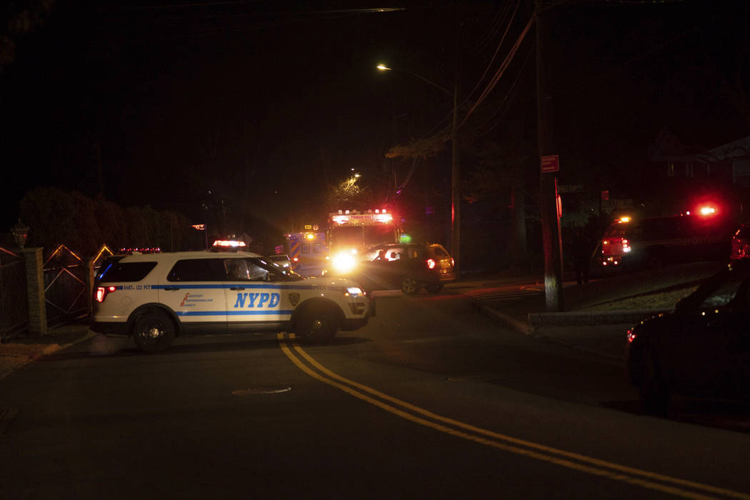 New York Police Department and New York City Fire Department units respond to a report of shots fired Wednesday, March 13, 2019, in the Todt Hill section of the Staten Island borough of New York. ...