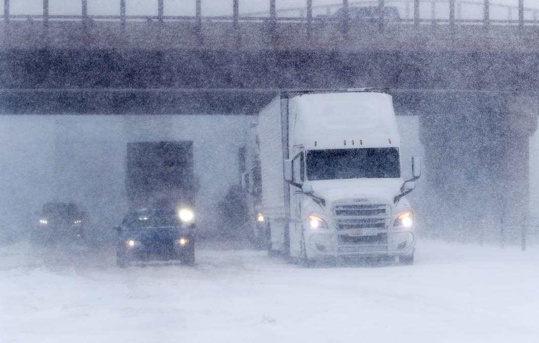 Traffic stops in the eastbound lanes of Interstate 70 near Tower Road as a late winter storm packing hurricane-force winds and snow sweeps over the intermountain West Wednesday, March 13, 2019, in ...