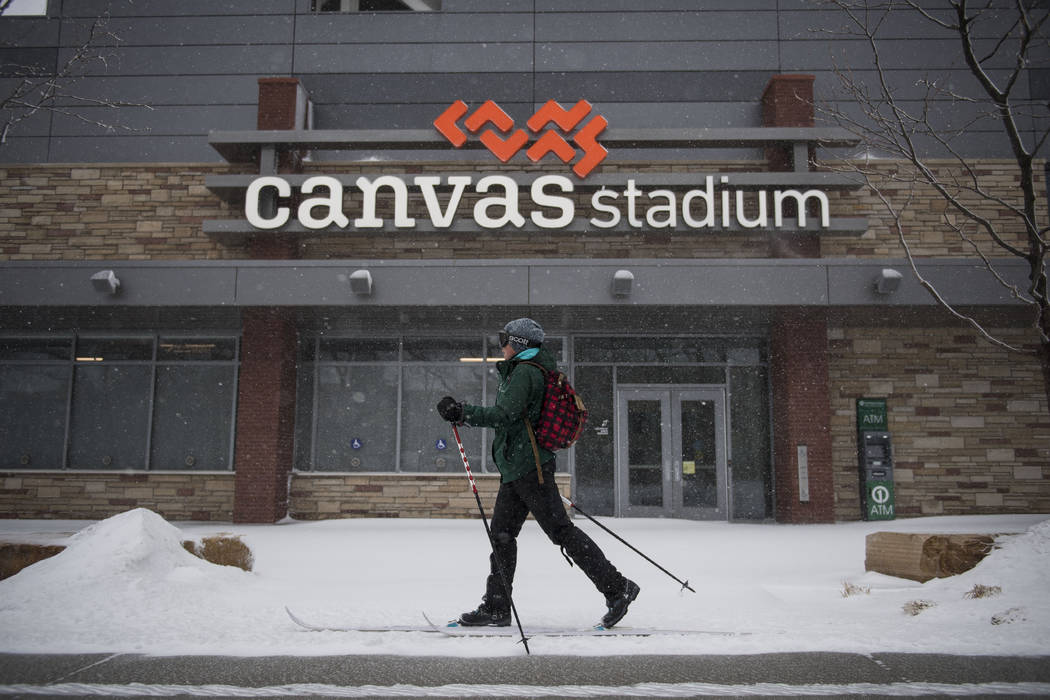 A cross country skier travels in the snow on Wednesday, March 13, 2019, in Fort Collins, Colo. A winter storm hit the western U.S., with blizzard conditions expected to engulf parts of Colorado, W ...