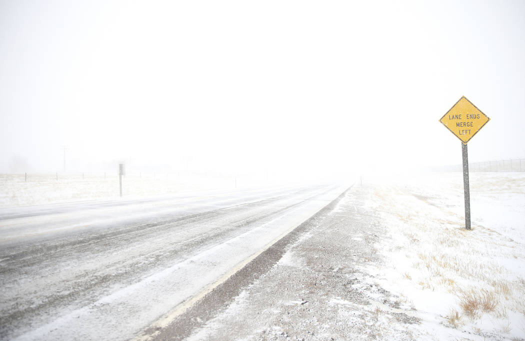 White-out conditions along Happy Jack Road during a blizzard on Wednesday, March 13, 2019, in Cheyenne. White-out conditions closed I-80, I-25, and U.S. 85, effectively closing off the state capit ...