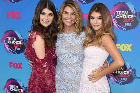 In this Aug. 13, 2017 file photo, actress Lori Loughlin, center, poses with her daughters Bella, left, and Olivia Jade at the Teen Choice Awards in Los Angeles. (Photo by Jordan Strauss/Invision/ ...