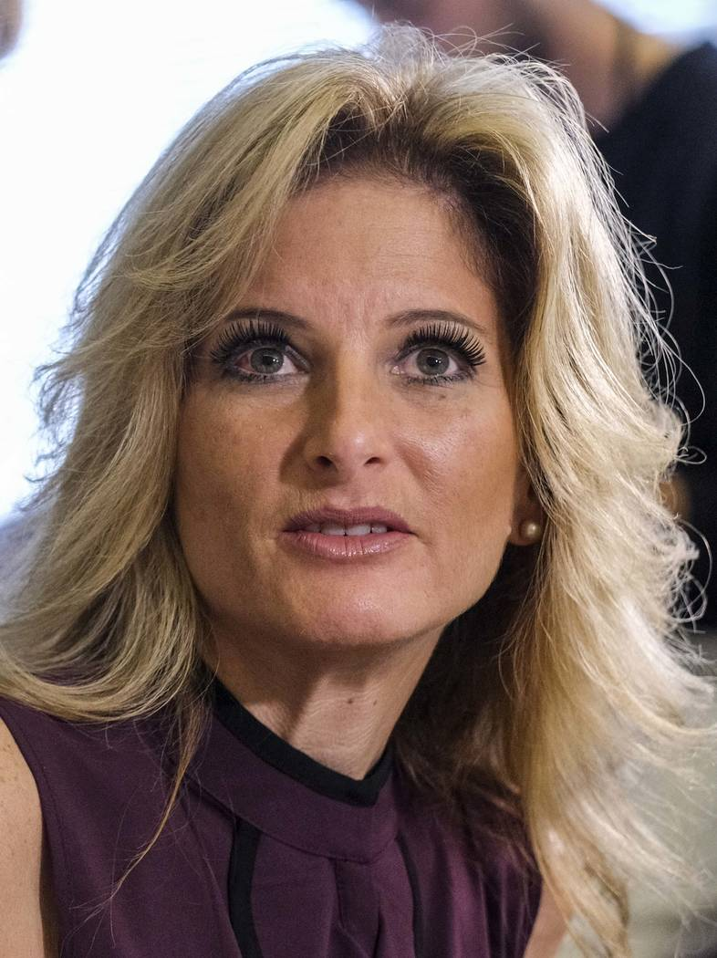 """Summer Zervos appears at a news conference with her attorney Gloria Allred in Los Angeles, Friday Oct. 14, 2016. Zervos, a former contestant on """"The Apprentice"""" says Republican presidential candid ..."""