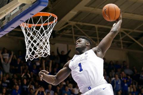 Duke's Zion Williamson (1) dunks during the second half of an NCAA college basketball game against Clemson, in Durham, N.C. on Jan. 5, 2019. Williamson was named both The Associated Press ACC play ...