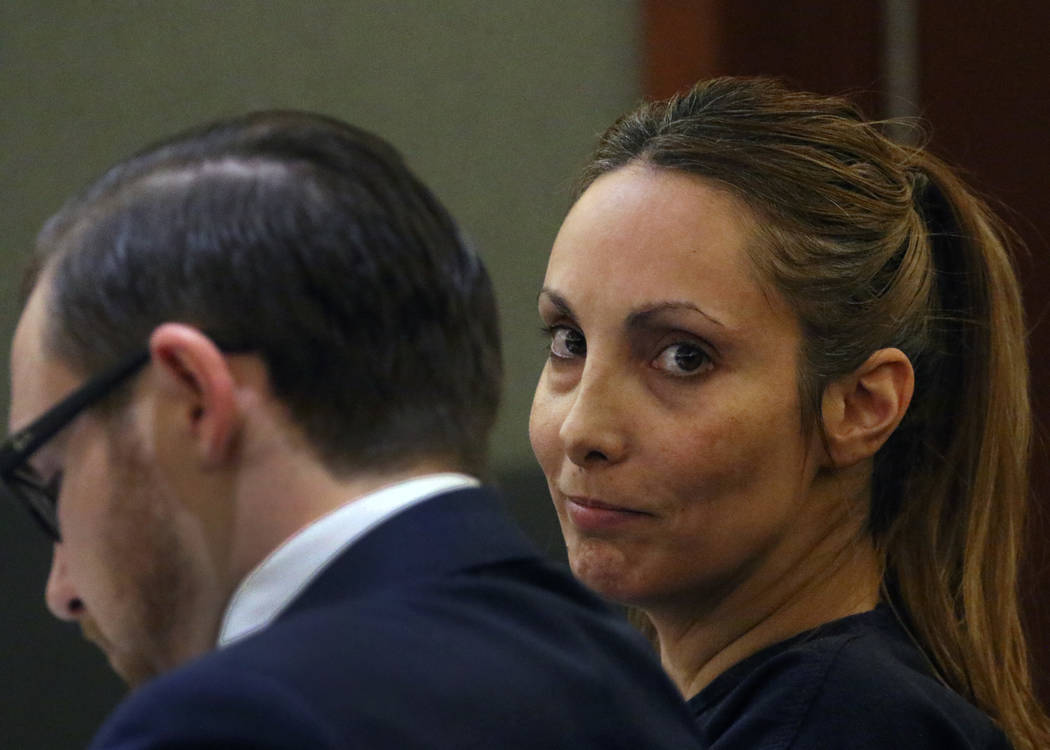 Alexis Plunkett, the jailed Las Vegas defense lawyer, appears in court with her defense attorney Adam Solinger during her bail hearing at the Regional Justice Center on Thursday, March. 14, 2019, ...