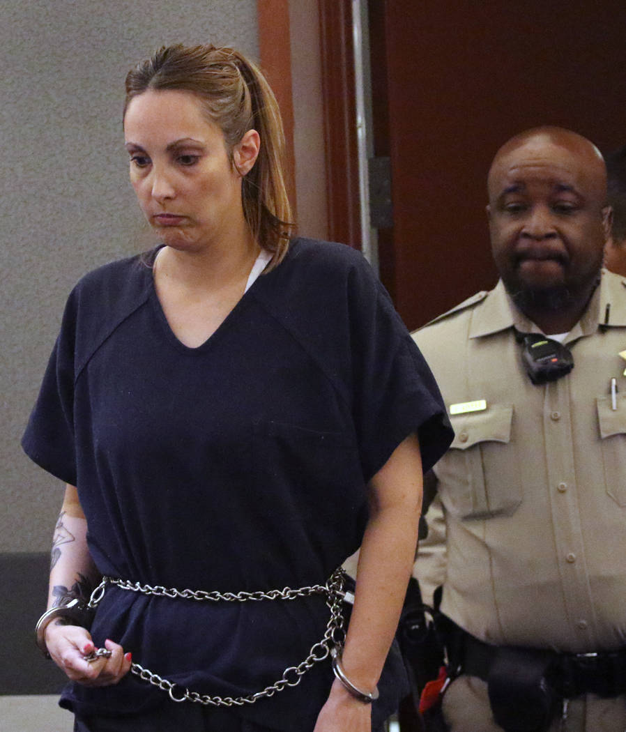Alexis Plunkett, the jailed Las Vegas defense lawyer, led into the courthouse during her bail hearing at the Regional Justice Center on Thursday, March. 14, 2019, in Las Vegas. Bizuayehu Tesfaye L ...