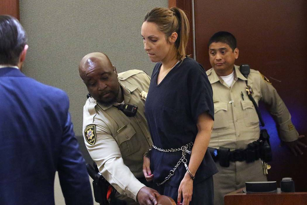 Alexis Plunkett, the jailed Las Vegas defense lawyer, led into the courthouse during her bail hearing as her defense attorney Adam Solinger, left, looks on at the Regional Justice Center on Thursd ...