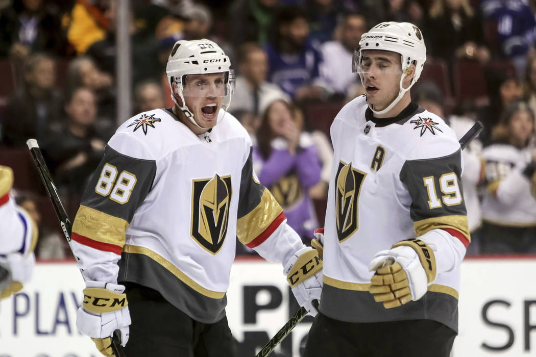 Vegas Golden Knights' Nate Schmidt (88) celebrates his goal with teammate Reilly Smith (19) during the second period of an NHL hockey game in Vancouver, British Columbia, Saturday, March 9, 2019. ...
