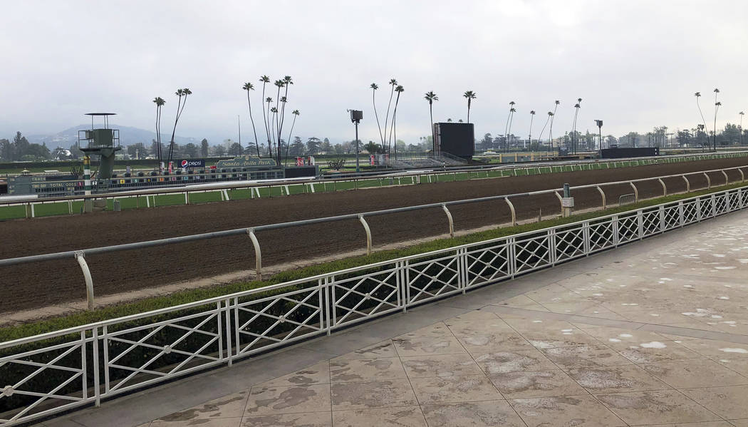 The home stretch and stands are empty at Santa Anita Park in Arcadia, Calif., Thursday, March 7, 2019. Extensive testing of the dirt track is under way at eerily quiet Santa Anita, where the death ...