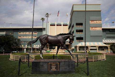 A statue of Zenyatta stands in the paddock gardens area at Santa Anita Park Tuesday, March 5, 2019, in Arcadia, Calif. A person with direct knowledge of the situation says a another horse has died ...