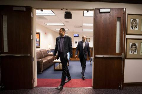 Senate Majority Leader Aaron Ford, D-Las Vegas, left, and Sen. Kelvin Atkinson, D-North Las Vegas, during the second to last day of the Nevada Legislature at the Legislative Building in Carson Cit ...