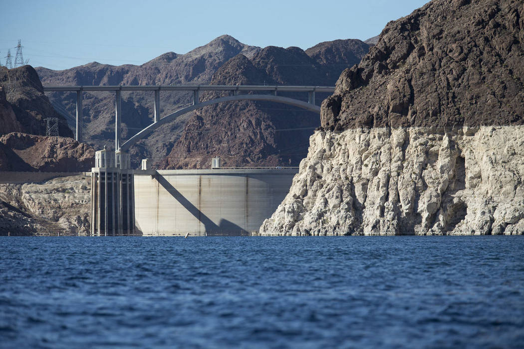 Hoover Dam and the Mike O'Callaghan-Pat Tillman Memorial Bridge are seen from the Colorado River's Black Canyon at Lake Mead National Recreation Area outside of Las Vegas on Wednesday, Oct. 17, 20 ...