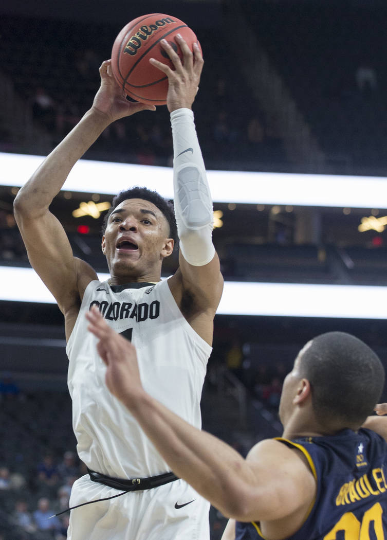 Colorado sophomore guard Tyler Bey (1), a Las Vegas native, drives over California freshman guard Matt Bradley (20) in the second half during the Buffalo's Pac-12 tournament game with the Bears on ...