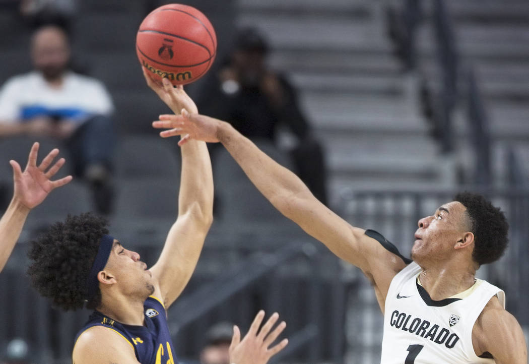 Colorado sophomore guard Tyler Bey (1), a Las Vegas native, blocks the shot of California sophomore forward Justice Sueing in the first half during the Buffalo's Pac-12 tournament game with the Be ...