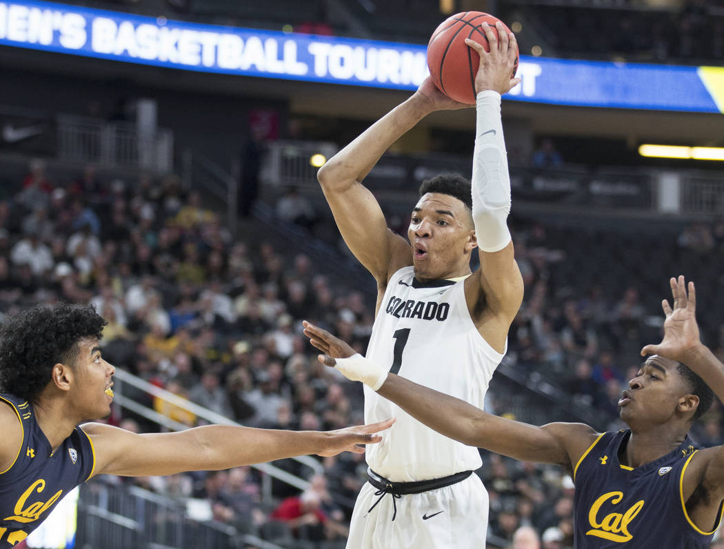 Colorado sophomore guard Tyler Bey (1), a Las Vegas native, grabs a rebound over California sophomore guard Juhwan Harris-Dyson (2) and freshman forward Andre Kelly (22) in the second half during ...