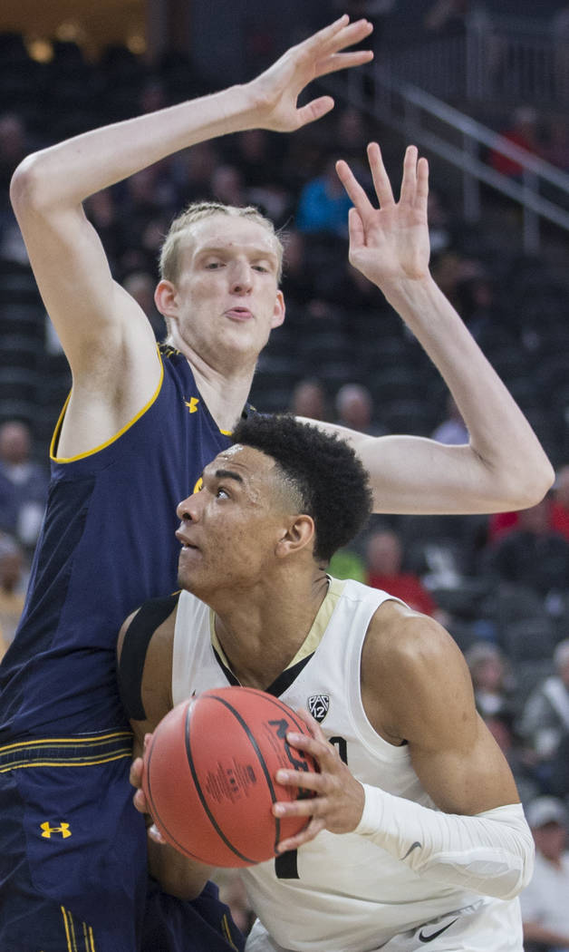 Colorado sophomore guard Tyler Bey (1), a Las Vegas native, fights for position with California freshman center Connor Vanover (23) in the second half during the Pac-12 tournament on Wednesday, Ma ...