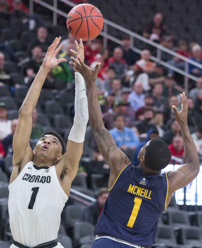 Colorado sophomore guard Tyler Bey (1), a Las Vegas native, fights for a rebound with California sophomore guard Darius McNeill (1) in the second half during the Pac-12 tournament on Wednesday, Ma ...