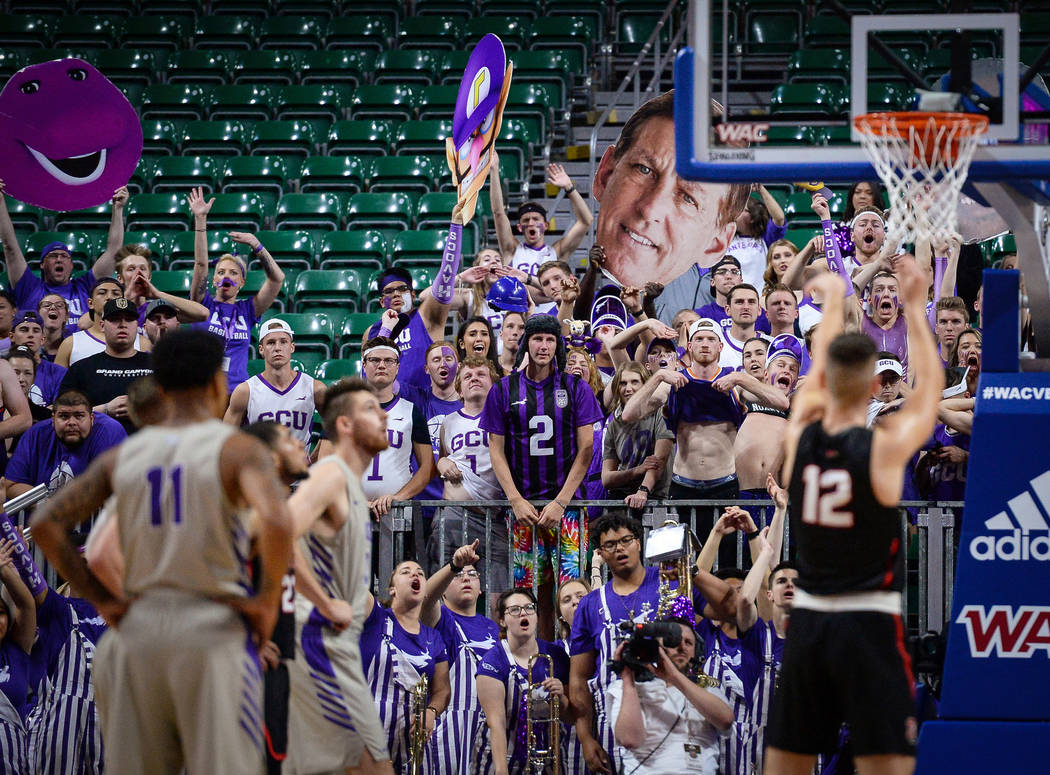 Fans in the Grand Canyon University student section attempt to distract Seattle University during a penalty shot in the second half of the opening round of the Western Athletic Conference tourname ...