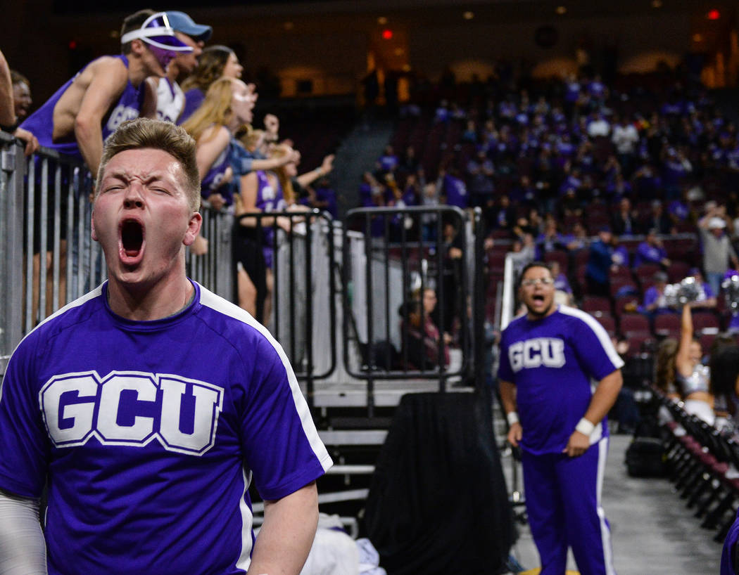 Grand Canyon University student Grayson Higgins cheers on the team in the second half of the opening round of the Western Athletic Conference tournament against Seattle University in Las Vegas, Th ...