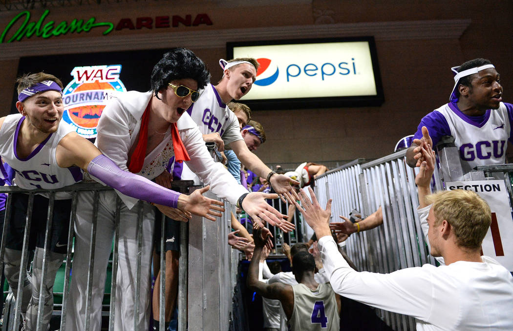 Fans in the Grand Canyon University student section high five the players after their win against Seattle University in the second half of the opening round of the Western Athletic Conference tour ...