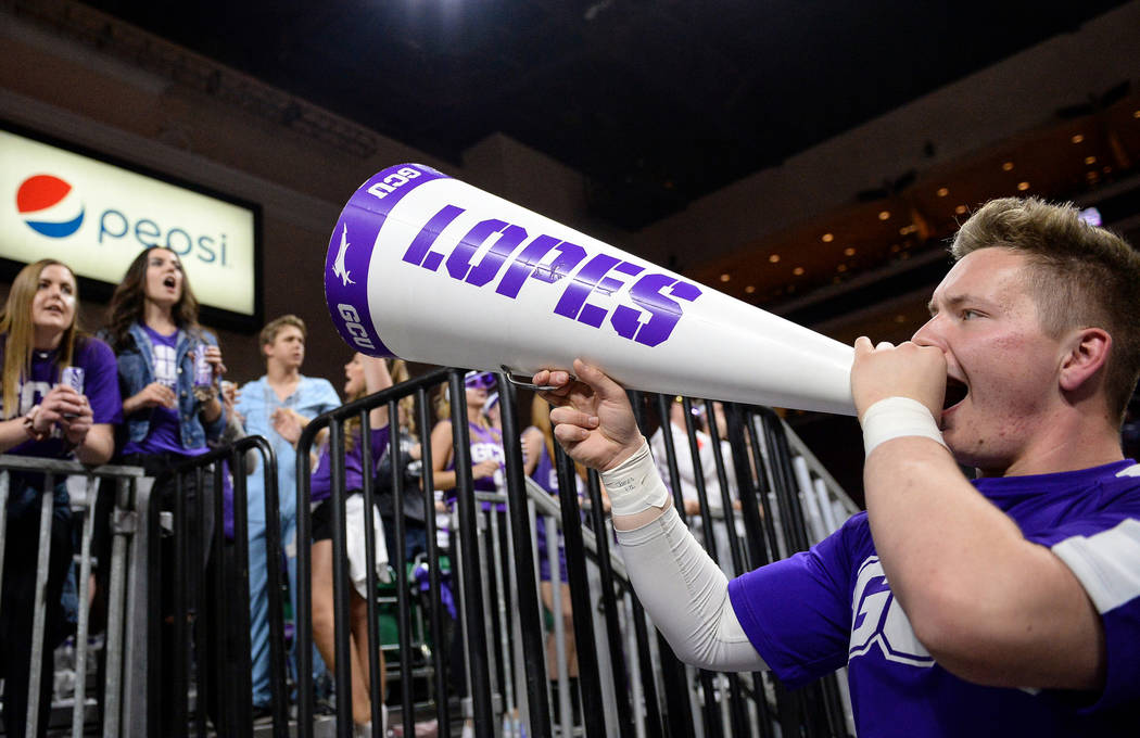 Grand Canyon University student Grayson Higgins cheers to the student section as they cheer on their team in the second half of the opening round of the Western Athletic Conference tournament agai ...