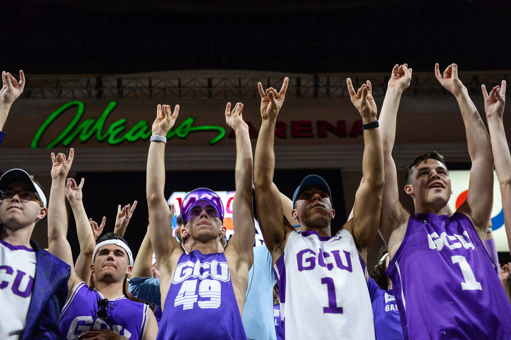 """Fans in the Grand Canyon University student section """"put their lopes up"""" to cheer on their team in the second half of the opening round of the Western Athletic Conference tournament agai ..."""