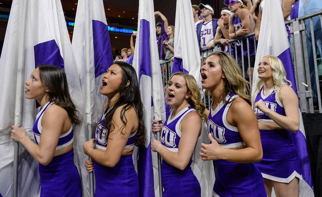 Cheerleaders in the Grand Canyon University student section cheer on their team in the second half of the opening round of the Western Athletic Conference tournament against Seattle University in ...
