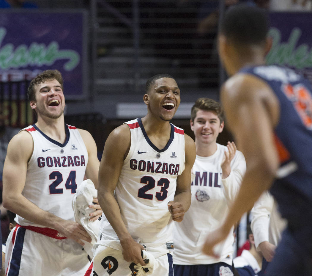 Gonzaga sophomore guard Zach Norvell Jr. (23) and sophomore forward Corey Kispert (24) cheer for their teammates in the second half during their West Coast Conference semifinal game with Pepperdin ...